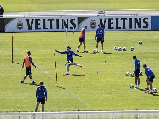Players of Bundesliga soccer club Schalke 04 exercise in Gelsenkirchen, Germany on Thursday ahead of the league's restart on Saturday.