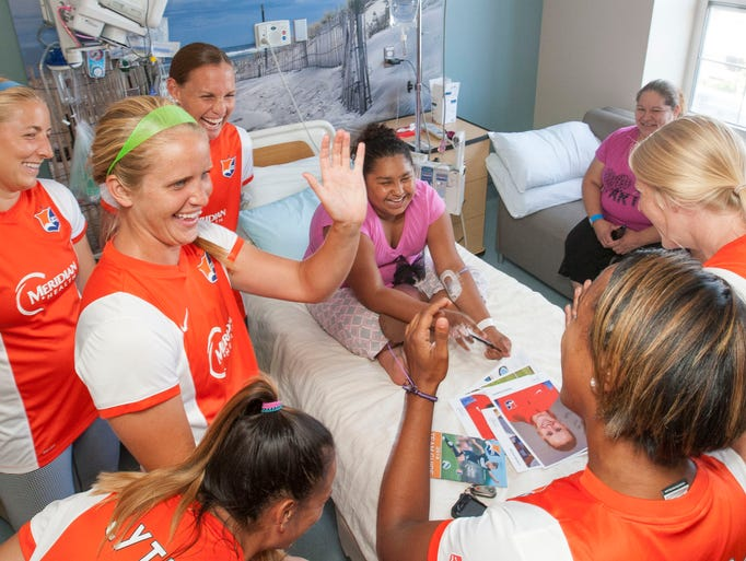 Members of the Sky Blue women's professional soccer team joke with Saira Valle, 10, Neptune, a patient at K. Hovnanian children's hospital at Jersey Shore University medical center in Neptune.  -  July 30, 2014-Neptune, NJ. Staff photographer/Bob Bielk/Asbury Park Press