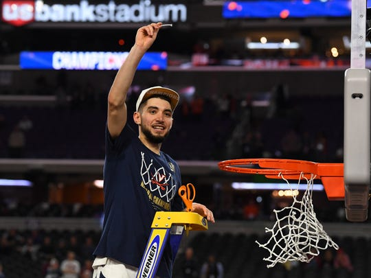 Apr 8, 2019; Minneapolis, MN, USA; Virginia Cavaliers guard Ty Jerome reacts to fans after cutting the net and defeating the Texas Tech Red Raiders in overtime in the championship game of the 2019 men's Final Four at US Bank Stadium. Mandatory Credit: Robert Deutsch-USA TODAY Sports ORG XMIT: USATSI-400702 ORIG FILE ID:  20190408_rvr_usa_239.jpg