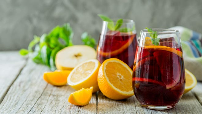 Our columnist shares sangria recipes featuring citrus (as here), strawberries and white peaches.