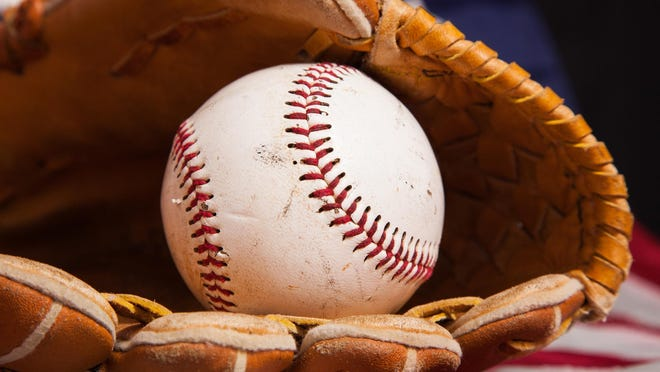 A baseball and glove with an American flag background.