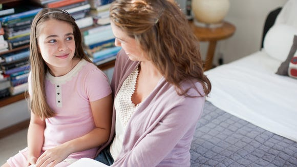 Talk with your child to reassure her. Credit: Getty Images
