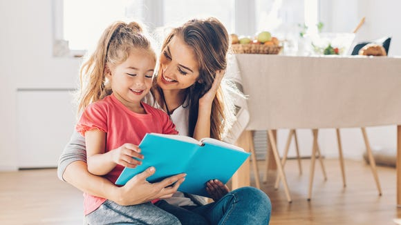 Mother and daughter reading book