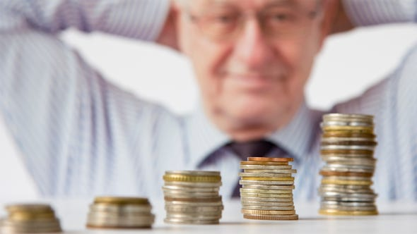 Successful retiree counting his money.