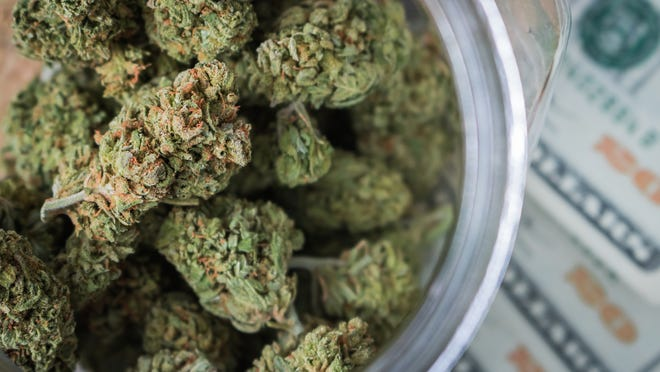Marijuana buds in a container.