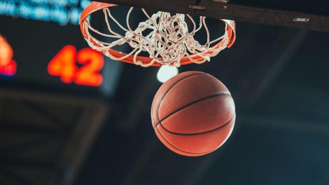A basketball swishes through a hoop.