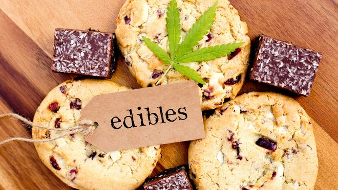 Edible cannabis cookies and candies on a table. Legalizing recreational marijuana has become a heated topic in various states.