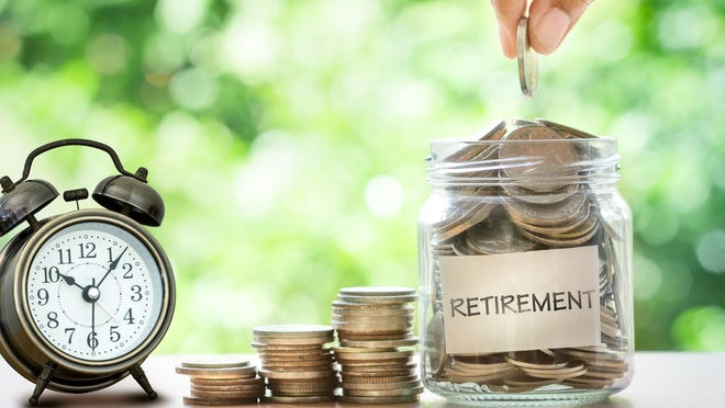 Retirement savings jar with money spilling out of it.