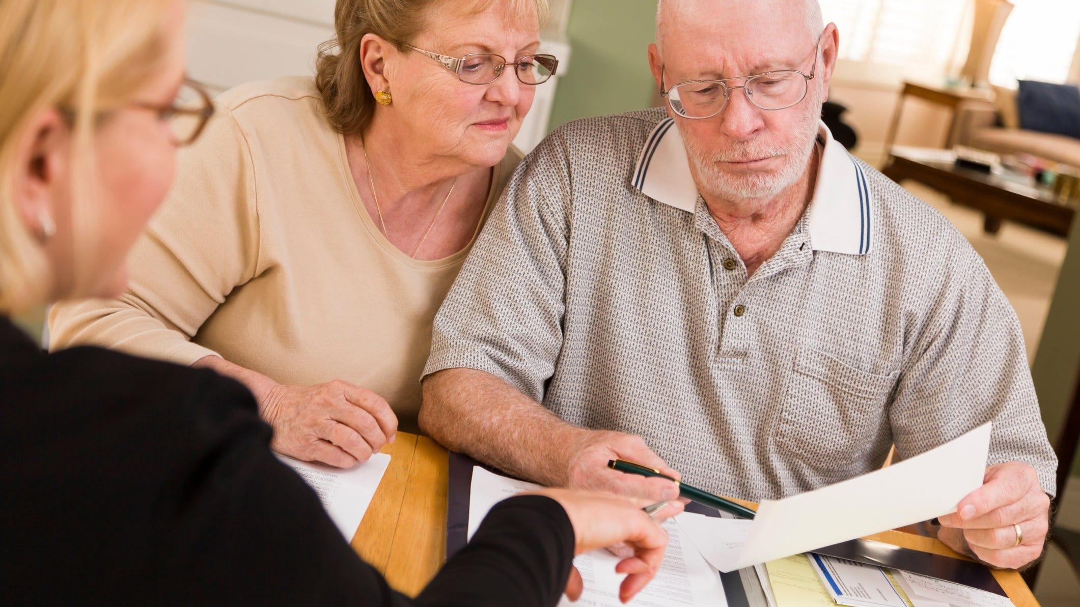 older couple looking at paperwork jpg?width=2121&height=1193&fit=crop&format=pjpg&auto=webp.'