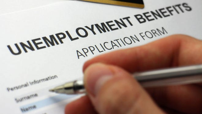 A unemployed worker fills out a jobless benefits application.