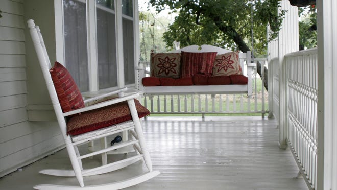 A front porch can be a comfortable outdoor room for the home. And it protects the front door from the weather.
