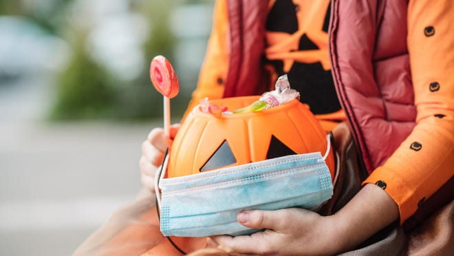Pediatricians say they would prefer to see kids take part in safer, virtual activities this year instead of trick-or-treating. But for those who do go door-to-door, they have some safety suggestions. [File Photo]