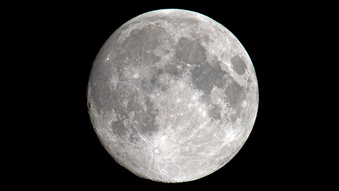 """The full """"worm"""" moon will rise in the eastern sky on Sunday evening, March 28."""
