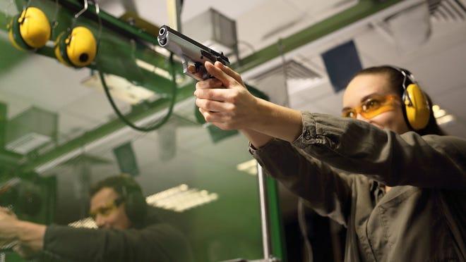 Woman shooting at gun range