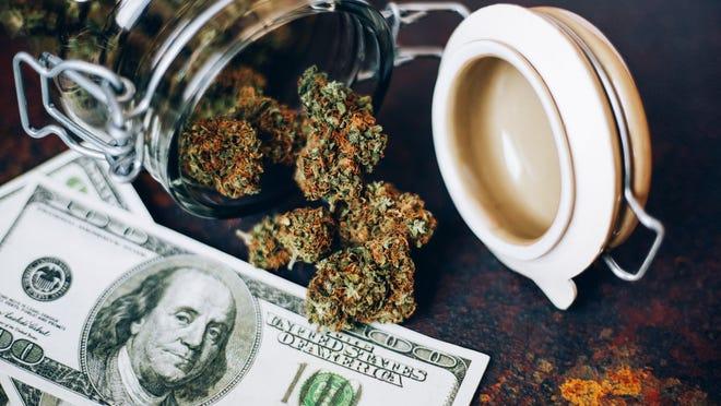 Jar of marijuana and $100 bills