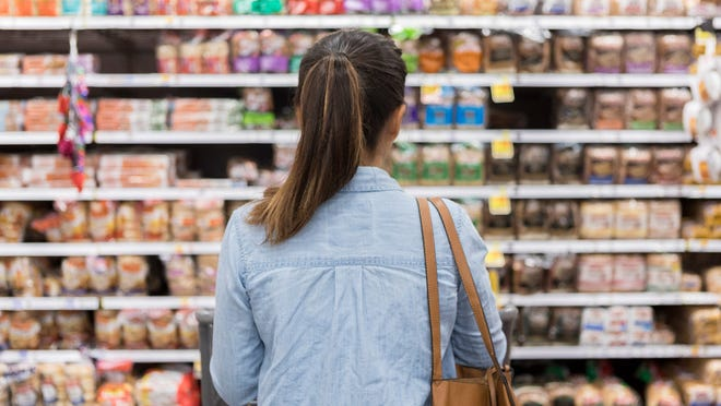 Woman shopping in a grocery store.