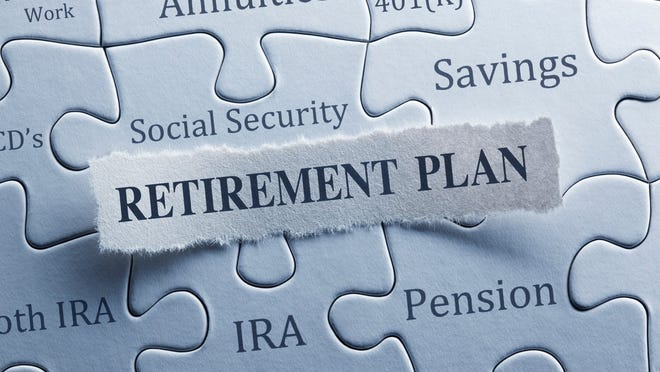 A jigsaw puzzle features words such as social security, IRA, pension, retirement plan.