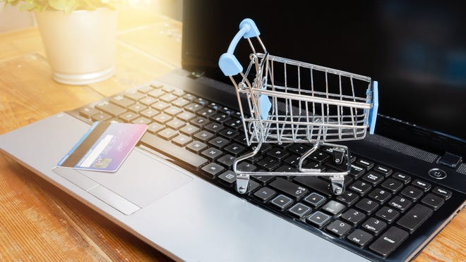 Shopping cart and credit card on laptop