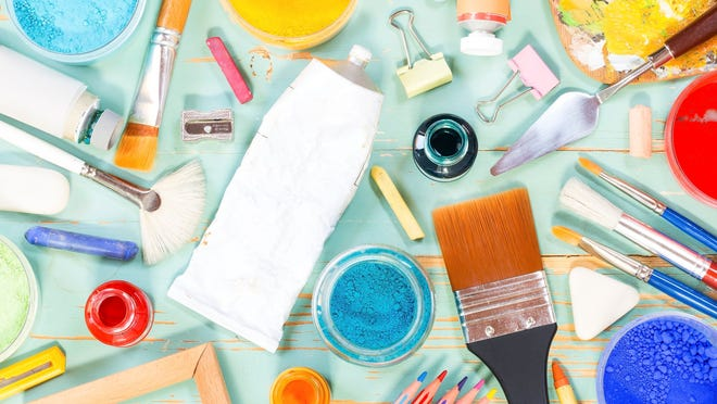 arts and crafts supplies including paints and brushes