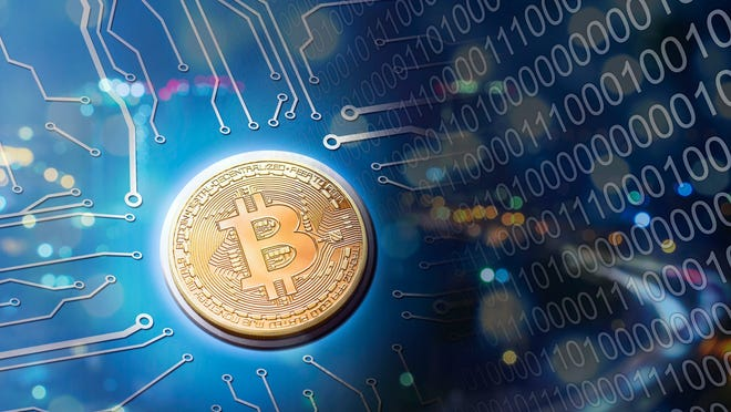 A gold coin with the Bitcoin symbol surrounded by computer code.