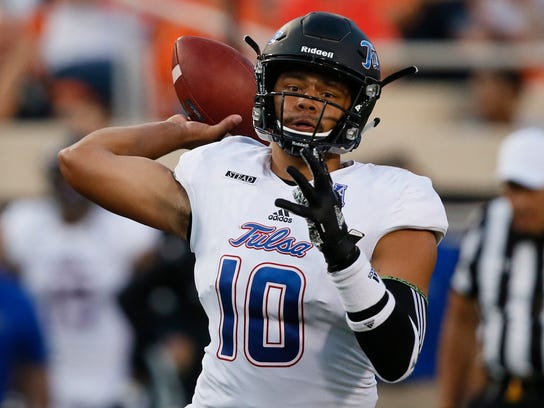 Tulsa quarterback Chad President (10) throws during the first half of an NCAA college football game against Oklahoma State in Stillwater, Okla., Thursday, Aug. 31, 2017. (AP Photo/Sue Ogrocki)