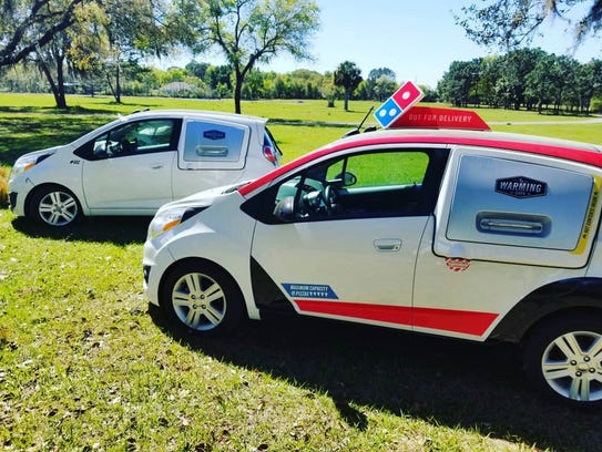Two Domino's DXP cars purchased by Samcrac.