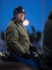 Trainer Bill Mott watched with a full moon over his