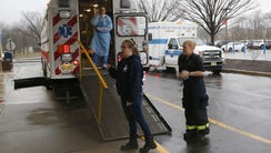 EMS and hospital personnel prepare to  transport patients
