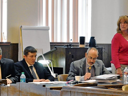 Robert Earley, 33, second from left, is on trial on charges of first-degree murder, kidnapping and tampering with evidence in the death of his girlfriend, 30-year-old Emily Lambert. The defense said Earley was intoxicated and is seeking a verdict of second-degree murder.