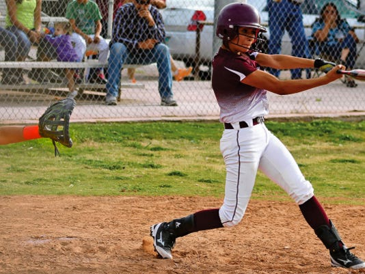 Peter Dindinger — Daily News Ember Cervantes connects with a pitch Thursday evening at the Tularosa High School softball field.