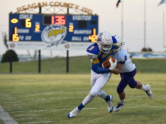 Reagan County's Kaleb Morris is tackled by an Irion