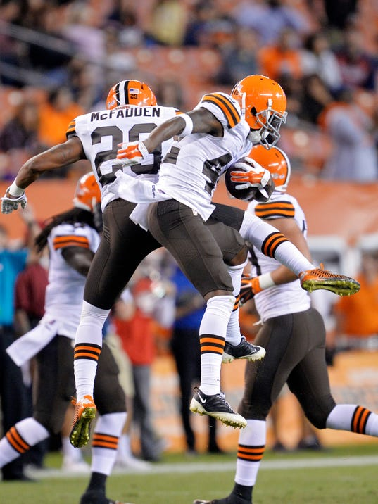 Cleveland Browns defensive back Robert Nelson (42) celebrates with Leon McFadden (29) after an interception against the Chicago Bears in the fourth quarter of a preseason NFL football game Thursday, Aug. 28, 2014, in Cleveland. (AP Photo/David Richard)