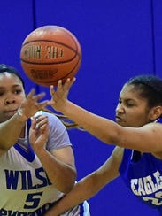 Wilson's Teniera Prioleau (5) reaches for the ball