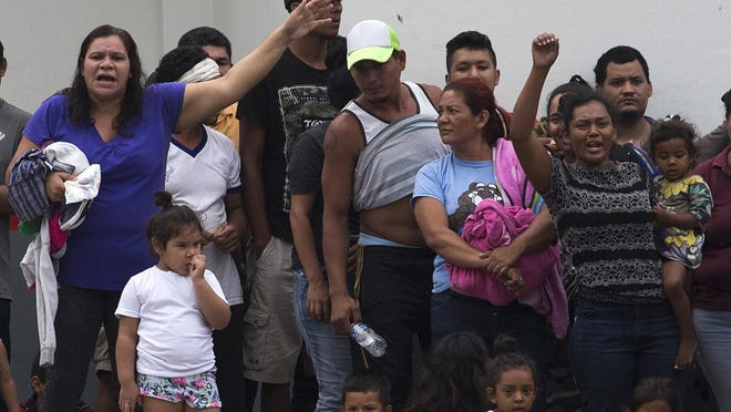 Migrants shout demanding better conditions or that they be transferred to another center, at a detention facility in Tapachula, Mexico.