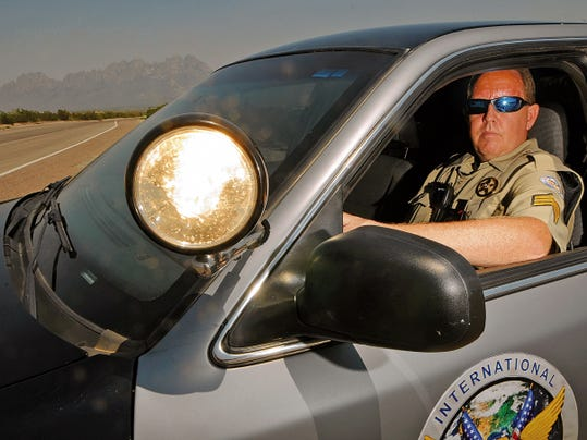 International Protective Services Matt Huebert sits in his vehicle on Wednesday.