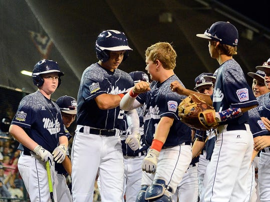 Red Land (Mid-Atlantic) players congratulate Cole Wagner after he hit a solo home run against Texas (Southwest) during Wednesday's game at the Little League World Series in Williamsport.