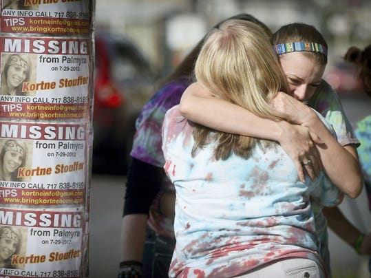 """Doreen Reem, foreground, a family friend of Kortne Stouffer, hugs Stouffer's sister, Kersten, Wednesday in Palmyra. Family and friends gathered to remember the third anniversary of Stouffer's disappearance and to replace aging """"Missing"""" signs in the area. Despite a 50,000 reward put up by the family, there are still no answers. Anyone with information that might be helpful may send it to Kortneinfo@gmail.com or call the Lebanon County District Attorney's Office at 717-228-4403."""