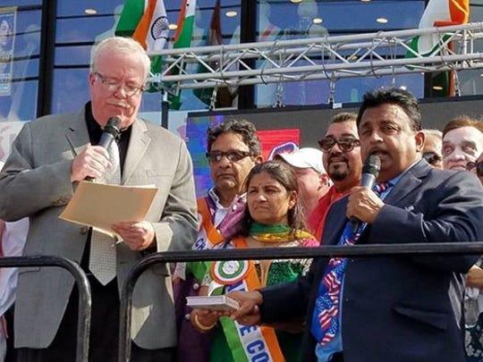 Woodbridge Mayor John E. McCormac swears in new township Councilman Viru Patel.