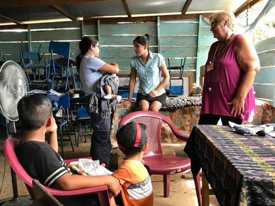 Members of the medical team examine clinic patients. A group from Wesley United Methodist Church embarked on a mission trip to La Soledad, Guatemala earlier this year to build a school and operate a medical clinic.