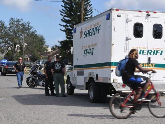 Cocoa Police surround home