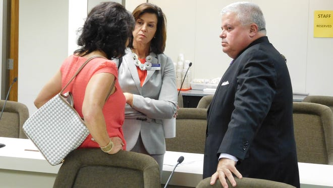 Now-former state Sen. Tom Apodaca and lobbyist Lisa Martin, center, listen to an unidentified woman after a committee meeting during this year's session of the state General Assembly. Apodaca is laying plans to become a lobbyist himself next year, a magazine reports.