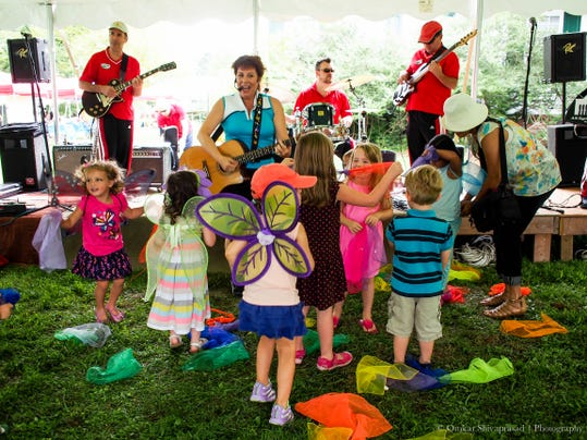 Dancing with Miss Amy during the 2013 Butterfly Festival.jpg