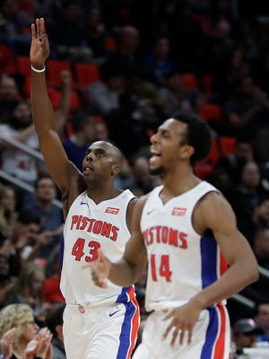 Detroit Pistons forward Anthony Tolliver (43) and guard Ish Smith (14) react after a basket by Tolliver during the second half of an NBA basketball game against the Indiana Pacers, Wednesday, Nov. 8, 2017, in Detroit.