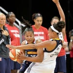 Connecticut's Alyssa Thomas, left, tries to fight her way through the defense of Indiana's Marissa Coleman during their game Saturday, May 23, 2015, at the KFC Yum! Center. (Photo by Timothy D. Easley/Special to the C-J)