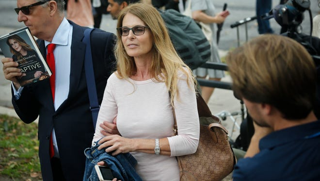 Catherine Oxenberg, center, leaving federal court in Brooklyn, July 25, 2018, in New York.