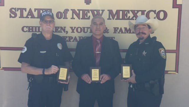 Carrizozo Police Chief Barnett accepting for  Jonathan Edwards, Carrizozo Police Department; Agent Eric Marrujo, New Mexico State Police; and Anthony Manfredi, Lincoln County Sheriff's Office. Not pictured, Officer Bryce Bailey, Ruidoso Downs Police Dept. and Jonathan Edwards.