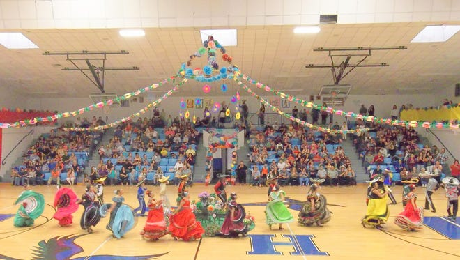 Dancers dazzle the audience at the annual Hondo Fiesta. The event is staged in the school gymnasium, which was stunningly decorated.