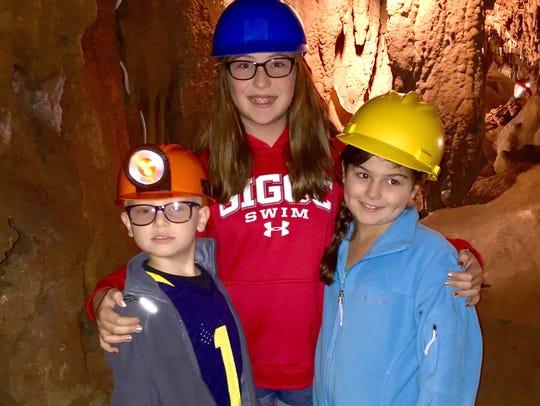 Sam, Julia and Sarah Shamus wear hard hats to explore