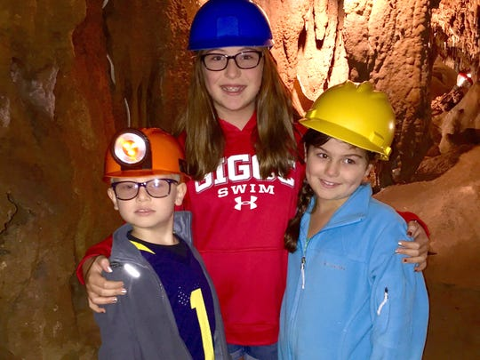 Sam, Julia and Sarah Shamus wear hard hats to explore