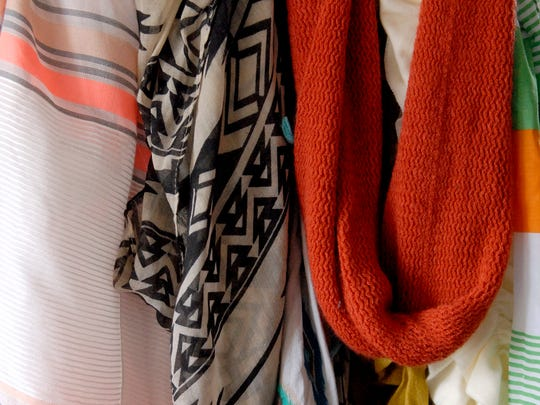 """A handful of the colorful scarves that inspire Stylemaker Courtney Lewis. """"It's a good way to add to an outfit.  The right scarf can make it casual or fancy,"""" she said.  March 15, 2017"""